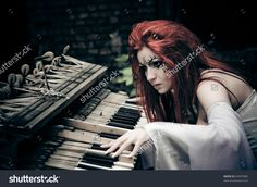 stock-photo-cute-gothic-girl-plays-on-piano-69947866.jpg (1500×1096)