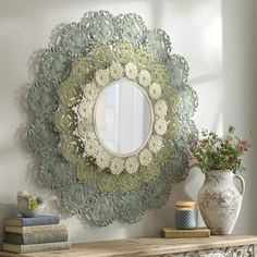 If you're looking for a feminine mirror, the Leila Metal Lace Mirror is just for you. The layered green and cream colors is gentle and soothing.