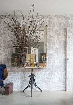 The door is wallpapered. Enigma wallpaper - Farrow and Ball