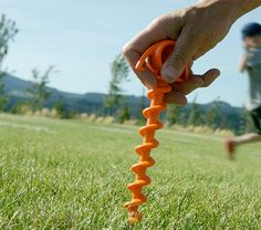 Orange Screw - Orange Screws are tent stakes built for extreme conditions, like high winds as well as screwing securely into sand to keep your sun shade from blowing down the beach.
