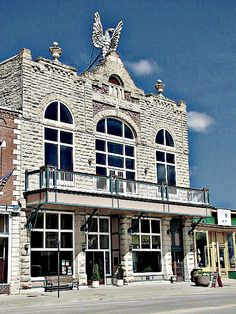 A huge eagle sits atop a historic building in downtown Wamego, Kansas.