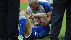 SALVADOR, BRAZIL - JUNE 22: An injured Ignazio Abate of Italy is given treatment during the FIFA Confederations Cup Brazil 2013 Group A match between Italy and Brazil at Estadio Octavio Mangabeira (Arena Fonte Nova Salvador) on June 22, 2013 in Salvador, Brazil. (Photo by Shaun Botterill - FIFA/FIFA via Getty Images)