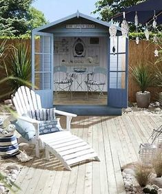 Beach escape in the backyard with a cute garden shed and wood patio.