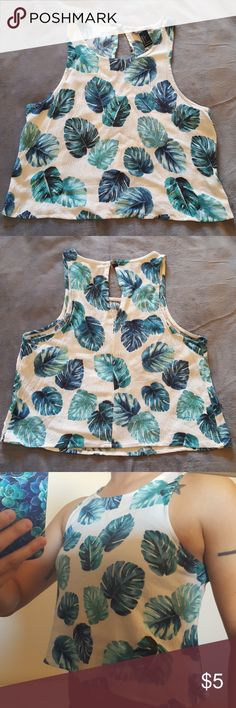 White crop tank top White crop tank top with blue/green tropical leaf design. Worn only a few times. Great shape. Lightweight material. Halter/sport style neckline. forever 21 Tops Crop Tops