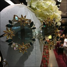 Slightly less than a full mannequin this Dolce-&-Gabbana Sunglass Modeling visual merchandising concept is complete with a DG branded necklace. Floral Headdress, Retail Fixtures, Store Displays, Visual Merchandising, Eyewear, Modeling, Commercial, Brooch, Spaces