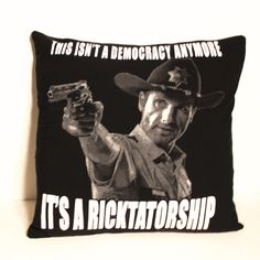 """One of a kind The Walking Dead pillow featuring the rather accurate caption """"This Isn't A Democracy Anymore...It's A RICKTATORSHIP"""". - As soft as your favorite tee shirt - 18"""" x 18"""" pillow - Envelope"""
