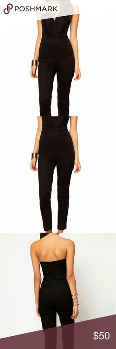 Jumpsuit with Pleated Bust An elegant fit anytime, this jumpsuit comes with a fitted bust with origami detailing to the front, a high waist and zip fastening on the reverse. The romper has been cut with a regular fit. You can't go wrong with this anytime. B-50 Pants Jumpsuits & Rompers