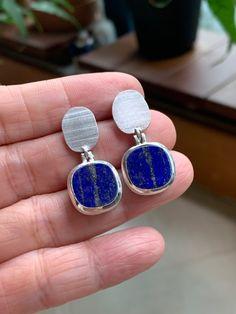 Lapis Lazuli set in Sterling Silver, beautiful texture, mat and bright finish. Made for pierced ears. Lapis Lazuli Earrings, Fine Jewelry, Jewellery, Beautiful Textures, Gemstone Colors, Jewelry Branding, Luxury Jewelry, Druzy Ring, Ear Piercings