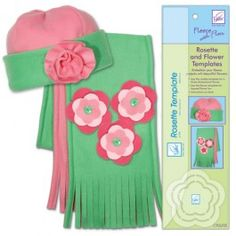 Rosette & Flower Template  Make Beautiful Fleece Rosettes or Daisy Flowers (Hat and Scarf not included)  Add 3-dimensional elements to your fleece projects with this fun rosette and flower template.   • For the rosette, simply cut the template design, add a running stitch to the bottom, gather and secure.   • For the flower, trace and cut as many sizes as you want to layer, and secure with June Tailor fleece glue. A center button can be added for more color.