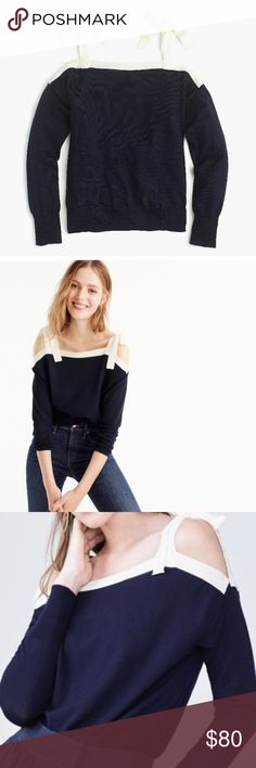 J. Crew merino wool cold shoulder sweater This adorable sweater is made of merino wool, hits slightly below hip. Size large (12-14). Color: Navy parchment. J. Crew Sweaters