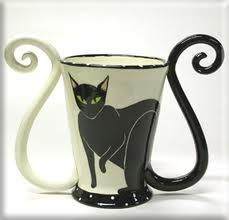 Two things that I like. Black cats and coffee. Beautiful cup. Have a good day and enjoy your coffee.  The Incensewoman