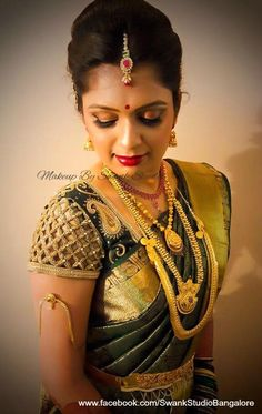 Bridal glow at it's best! Our bride Chetana looks mesmerizing for her muhurtam. Makeup and hairstyle by Swank Studio. Red lips. Armlet. Bridal jewelry. Bridal hair. Silk sari. Bridal Saree Blouse Design. Indian Bridal Makeup. Indian Bride. Gold Jewellery. Statement Blouse. Tamil bride. Telugu bride. Kannada bride. Hindu bride. Malayalee bride. Find us at https://www.facebook.com/SwankStudioBangalore