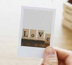 Take pictures of the kids artwork & make an album. Tape to the wall using washi tape? Or set against various backgrounds... Tape to brick, tape to car, tape to tree... Take to grandma's & tape to wallpaper!