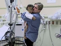 Johanne Wagner holds her 3-year-old daughter Phuoc before her liver transplant operation on Tuesday.