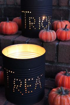 For an easy and affordable way to decorate your home this Halloween, make luminaries using paint, candles, and empty tin cans.