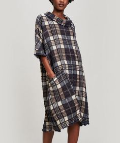 346fa7b6aafe This funnel neck dress from Parisian brand Crea Concept offers a pleasing  cocoon cut and plaid