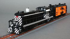 Road switcher, powered by two Power Functions L-Motors, geared Head and rear lamps are each lit by a Power Functions LED. Lego City Train, Lego Trains, Lego Mountain, Lego Kits, Train Engines, Lego Design, Lego Projects, Model Train Layouts, Custom Lego