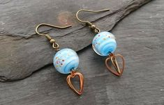 Blue lamp work glass bead and heart charm earrings Handmade Lamps, Handmade Jewellery, Earrings Handmade, Organza Gift Bags, Heart Charm, Antique Gold, Heart Shapes, Glass Beads, Delicate