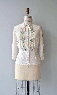Vintage 1930s ivory silk blouse with delicately hand-painted flowers down the front and both sleeves, clear resin buttons tie detail at neckline. --- M E A S U R E M E N T S --- fits like: small shoulder: 17 bust: 34-36 sleeve: 17 length: 22 brand/maker: n/a condition: excellent ➸ More tops & sweaters https://www.etsy.com/shop/DearGoldenVintage?section_id=5800171 ➸ Visit the shop http://www.DearGolden.etsy.com _____________________ ➸ inst...