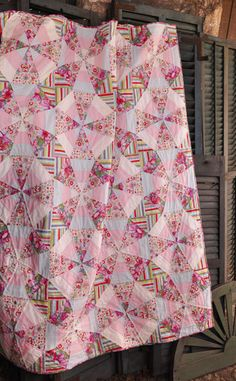 Mary McGuire Design: Whirl. Lovely soft prints and colors. Great design with the stripes and flowers - different !