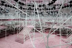 For Dior's spring 2015 couture presentation, the interior of the Musée Rodin was transformed with elaborate scaffolding and pink carpeting.