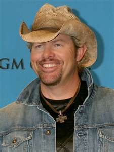 Toby Keith- brings a smile to my face :) And a smile to my heart, liver, elbow, and every part of me. :D