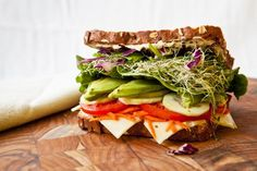 "UNIQUE Snack: uses sprouts, tomato, grated carrot, Low-fat muenster cheese, cucumber, romaine lettuce, avocado & whole grain bread. ***27 Grams of Protein 19 Grams of Total Fat ==>Dietary fiber: 23 grams | ""Overstuffed Veggie Sandwich""  #Vegetarian  #Sandwich"