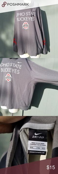 """Nike Dri Fit Ohio State Buckeyes Pullover Size XXL. Has a cinch neck, """"winged"""" style arms, and a waistband bottom. So it's fitted around the belly. 28"""" across chest, 26"""" long, 23"""" waistband. If you have a belly this will fit weird. Nike Tops Sweatshirts & Hoodies"""