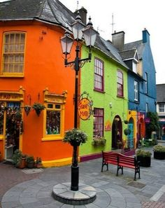Kinsale (Country Cork), Ireland.  Kinsale is known as the 'gourmet capital' of ireland, loads of fantastic restaurants in a beautiful small town. {I adore the cheerful, and brightly painted stores... awesome}