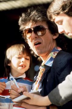 George Harrison and Dhani in 1985 at Brands Hatch (ROLF HAMILTON/AFP/Getty Images)