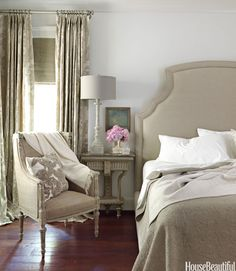 In a Mountain Brook, Alabama, house, designed by Tracery Interiors, patterns and textures give a greige-toned bedroom a subtle richness. Walls are Benjamin Moore's Revere Pewter. The Bernhardt bed in natural linen is from Three Sheets. Throw pillow from Ankasa.   - HouseBeautiful.com