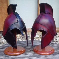 """The Corinthian larp leather helmet with cheek guards (""""The Corinthian"""") has been hand made out of a variety of layers of 3.5mm veg. tanned leather, it was designed and made by the armourer Alex Agricola of Black Raven Armoury. taking…Read more ›"""