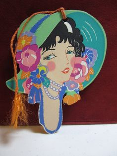 Gorgeous gibson 1920's-30's die cut bridge tally beautiful girl with very elaborately decorated bonnet unused colorful.  via Etsy.