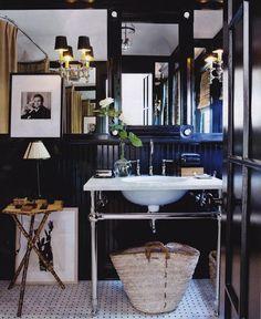 A modern day Mr. Big's bachelor pad bathroom -- love... Note black walls