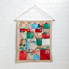 Nothing says Christmas like this colorful modern advent calendar.  It's filled with vibrant holiday hues and patterns.  Each of the nifty pockets can hold little treats and gifts for the kids to celebrate Christmas all month long.