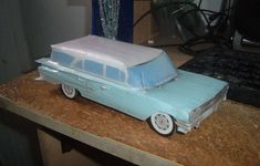 This paper car is a 1960 Chevrolet Impala Parkwood Station Wagon, a full-size car built by Chevrolet, the paper model is created by Michael Dazzo, and the