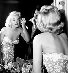 Marilyn Monroe getting dolled up.