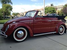 Kevin Cauchon, Riverside, CA, U.S.A. Hot VWs' Front cover of July 2013 issue. 1963 Ruby Red VW Cabriolet with 61' Taillights and hood. 40hp with 1300 heads and cam so it's a 1354. Lowered mildly at 1.5 inches in front. Smoothy rims with Coker radial whitewalls. Converted to 12volt for 6 speakers and 2 amps. TMI interior and Wolfsburgwest carpet kit.