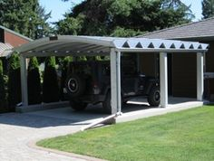I added this carport to the front of my barn, so I could park my newly redone GMC truck.  It looks great . . . kind of like a portico.