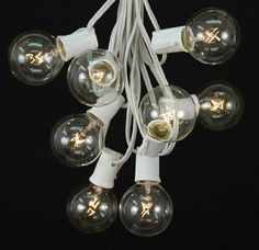 Amazon.com: Novelty Lights, Inc. G50-SET-WW-CL Globe Outdoor Patio Party String Light Set, Clear, White Wire, 25': Patio, Lawn & Garden