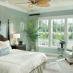 SW Silvermist - love the dark wood against the paint color, curtains and bedding