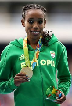 #RIO2016 Almaz Ayana of Ethiopia poses with the gold medal for the Women's 10000 Meters Final after setting a new world record of 291745 on Day 7 of the Rio...