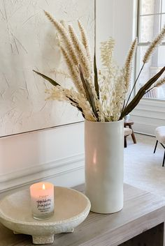 Create texture and light with a few simple florals in your home this fall. Mix faux foxtail grass with dried sea holly to recreate this look by @housetohavendesign. Shop faux and dried fall florals at Afloral.com.