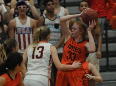 Ames' Katelyn Courtney rebounds the ball around West Des Moines Valley's Jackie Feldt during the first quarter in the girl's regional final at West Des Moines Valley High School's gym Tuesday, Feb. 21, 2017, in West Des Moines, Iowa. Photo by Nirmalendu Majumdar/Ames Tribune http://www.amestrib.com/sports/20170222/girls-basketball-ames-season-ends-with-loss-to-valley