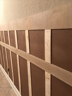 Easy DIY board and batten. Must cover textured walls with first layer and tie it into existing baseboards. #DIY #boardandbatten