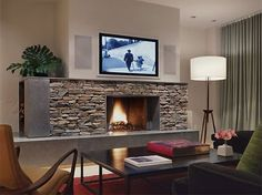 Love the fireplace and TV solution