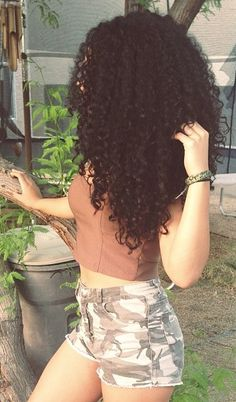 Natural curly hair!! Big hair is awesome!! It doesn't have to be long but it has to be healthy!!