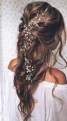 Bigger is better when it comes to most things in life: love, food and definitely hair. There's no better way to compliment your drop-dead gorgeous dress than with flawless curls or an awe-inspiring updo. We are totally obsessed with big, dramatic, romantically styled wedding hair right now and you w