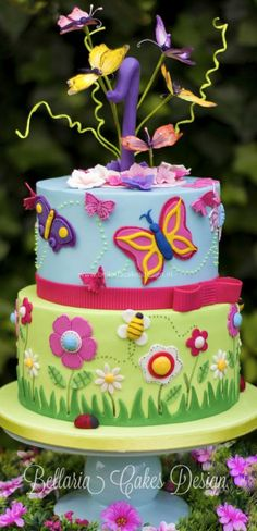 Butterflies garden birthday cake - Butterflies garden themed cake for the very first Birthday of a little girl. I've used bright colors and decorated the top tier with butterflies, made of flower paste. I've just fallen in love with this cake. Garden Birthday Cake, Butterfly Birthday Cakes, Birthday Cake With Flowers, Butterfly Cakes, Birthday Cake Girls, Butterfly Party, Butterfly Flowers, Garden Theme Cake, Bolo Artificial