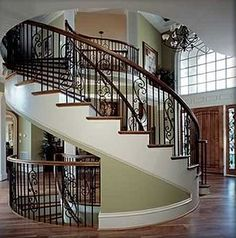 Beautiful Spiral staircase to multiple floor levels (looks like it would save some floor space)-- consider moving furniture, tho--- =/
